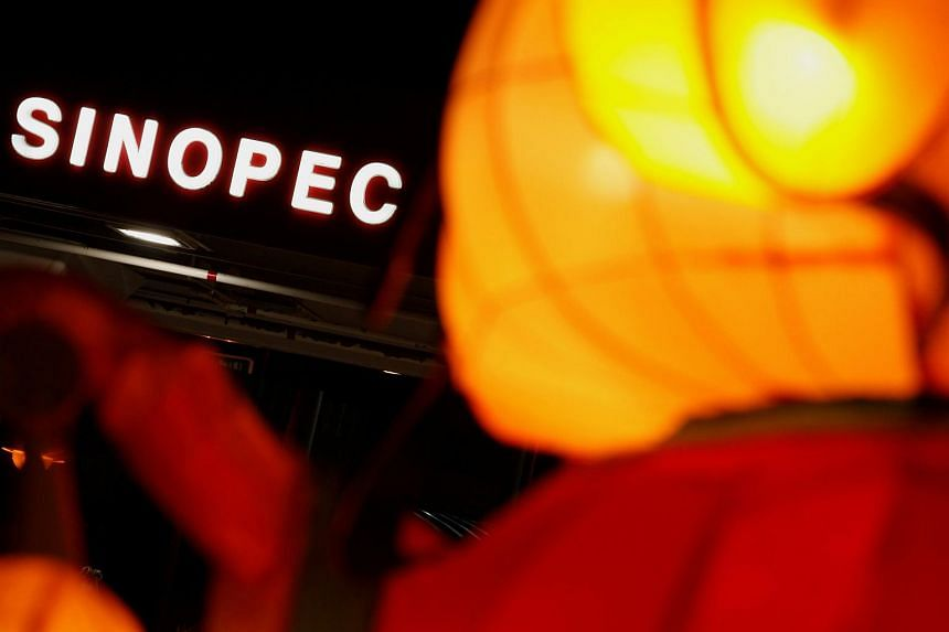 A Sinopec sign displayed at its gas station is seen behind a Chinese New Year lantern installation in Hong Kong, China.