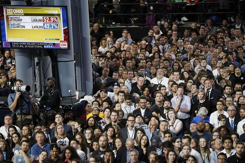 Supporters of Democratic US presidential nominee Hillary Clinton watching election returns in Ohio at the election night rally in New York, US, on Nov 8, 2016.
