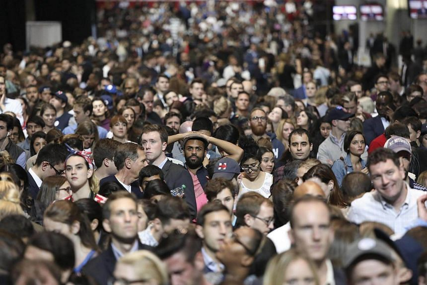 People watching as results come in at Mrs Hillary Clinton's election night event at the Javits Center in New York on Nov 8, 2016.