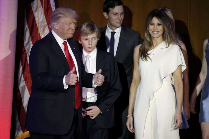 New US President-elect Donald Trump greets supporters along with his wife Melania and family.