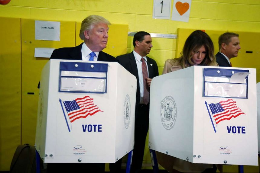 Republican presidential nominee Donald Trump and his wife Melania Trump vote at PS 59 in New York, New York, US, on Nov 8, 2016. PHOTO: REUTERS