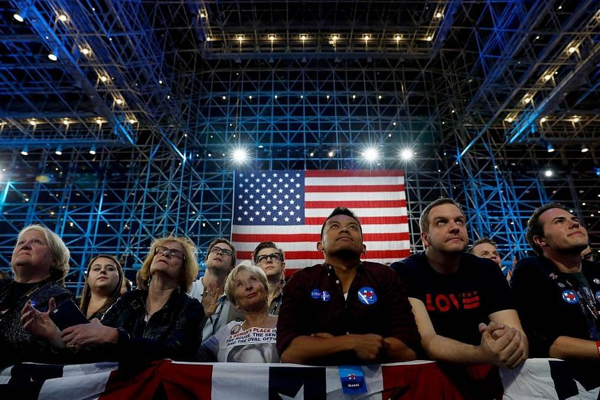 People watch voting results flowing in at Democratic presidential nominee Hillary Clinton's election night event at the Jacob K. Javits Convention Center on Nov 8, 2016, in New York City.