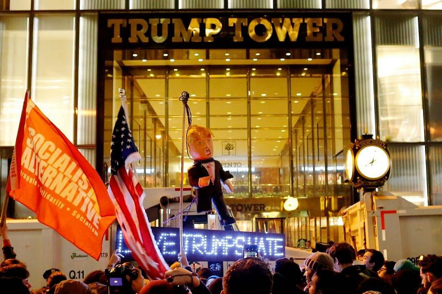 Protesters reaching Trump Tower as they march against Republican President-elect Donald Trump in Manhattan, New York, on Nov 9, 2016.