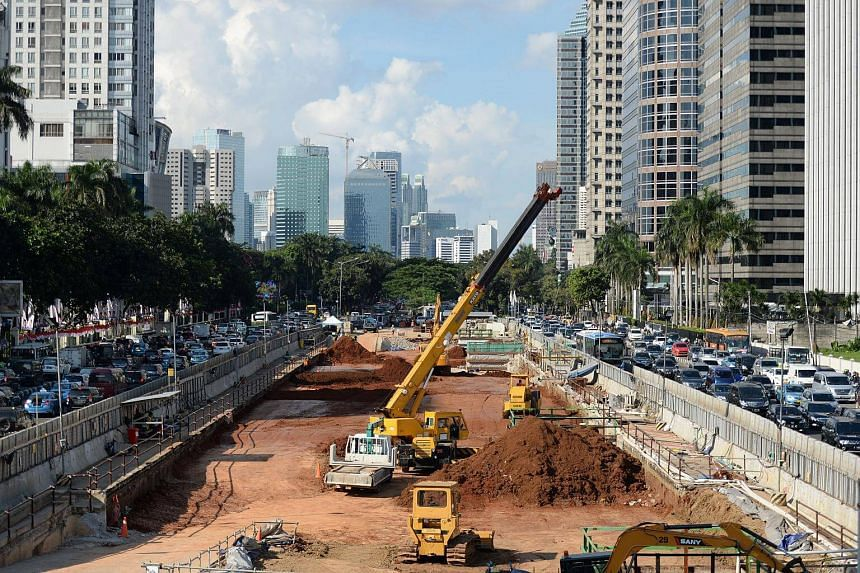 An excavator operates at a Jakarta Mass Rapid Transit (MRT) construction site in Jakarta, Indonesia. Indonesia's annual economic growth is expected to pick up to around 5.2-5.3 per cent in the current quarter.