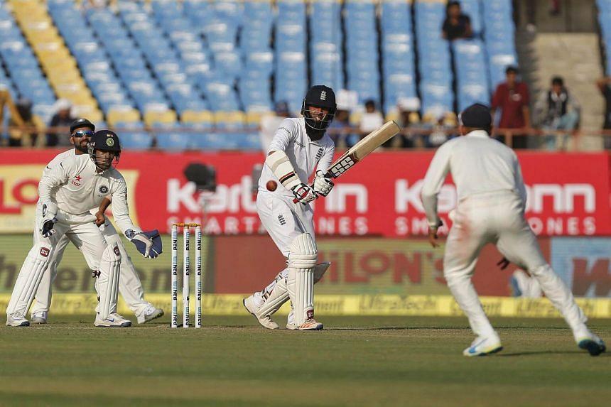 England's Moeen Ali plays a shot on Nov 9, 2016.