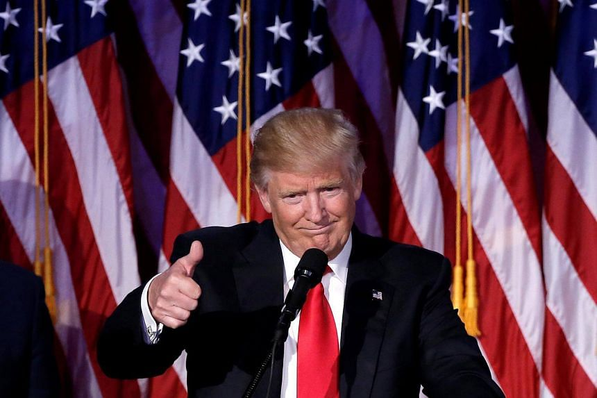 US President-elect Donald Trump gestures as he speaks at election night rally in Manhattan, New York.