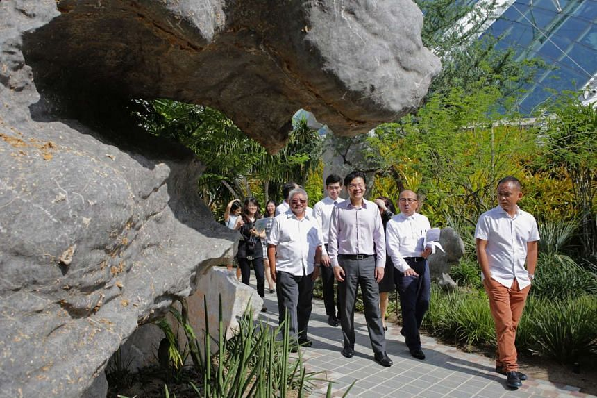 Minister for National Development Lawrence Wong takes a walk along the trail with Gardens by the Bay CEO Dr Kiat W. Tan, and (third from left) landscape architect Junichi Inada.