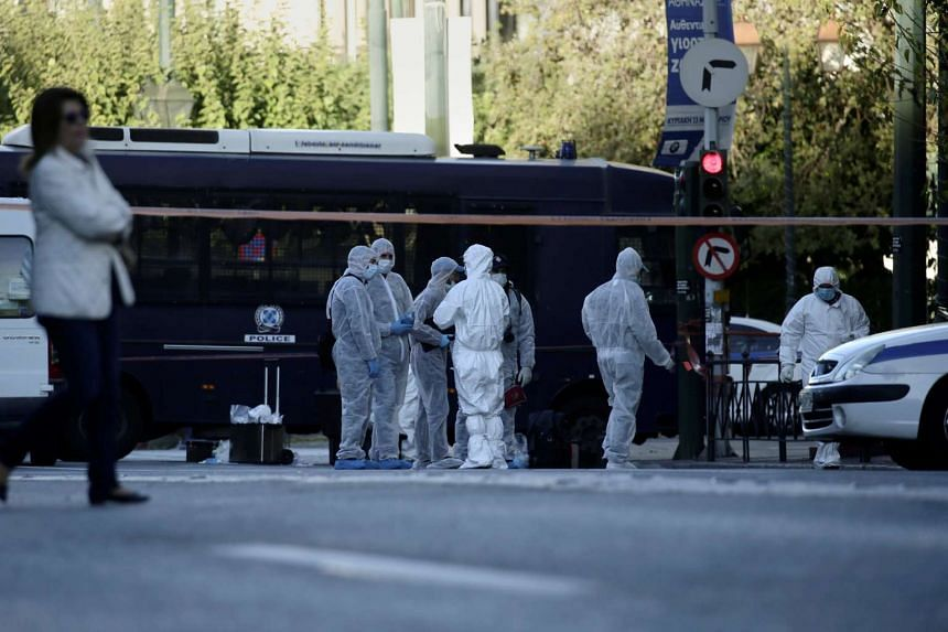 Forensics experts search for evidence outside the French embassy, where unidentified attackers threw an explosive device causing a small blast, in Athens, Greece on Nov 10, 2016.