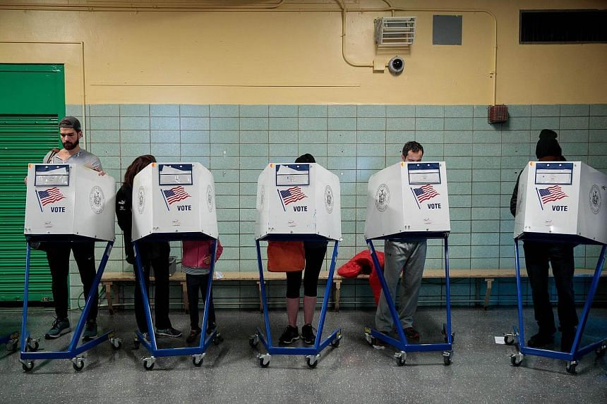 People voting at a polling site at Public School 261, on Nov 8, 2016, in New York City.