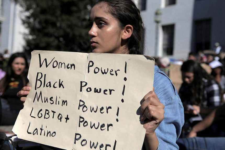 Berkeley High student Ariana Melton, 16, holding a sign during a protest in response to the election of Donald Trump as President of the United States in Berkeley, California, US, on Nov 9, 2016.