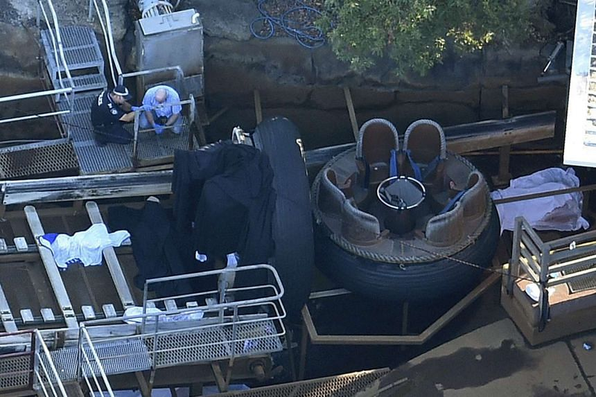 Queensland Emergency service personnel inspecting the scene of an accident at the Dreamworld theme park, in Coomera, on the Gold Coast, Queensland, Australia. The Thunder River Rapids amusement ride will be demolished following the accident in which