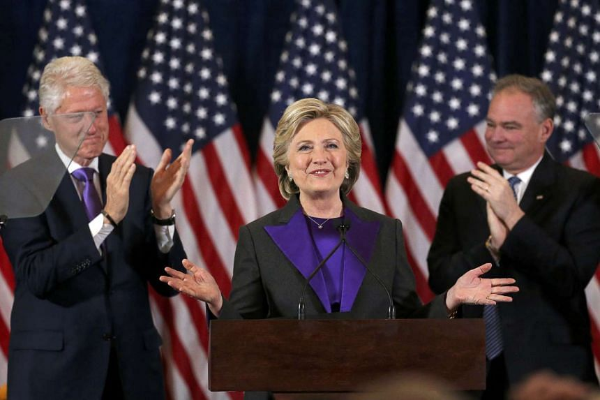 Democratic presidential candidate Hillary Clinton, with her husband, former US President Bill Clinton, (left), and her Vice-President running mate Tim Kaiine (right), applaud at her concession speech to President-elect Donald Trump in New York, US, N