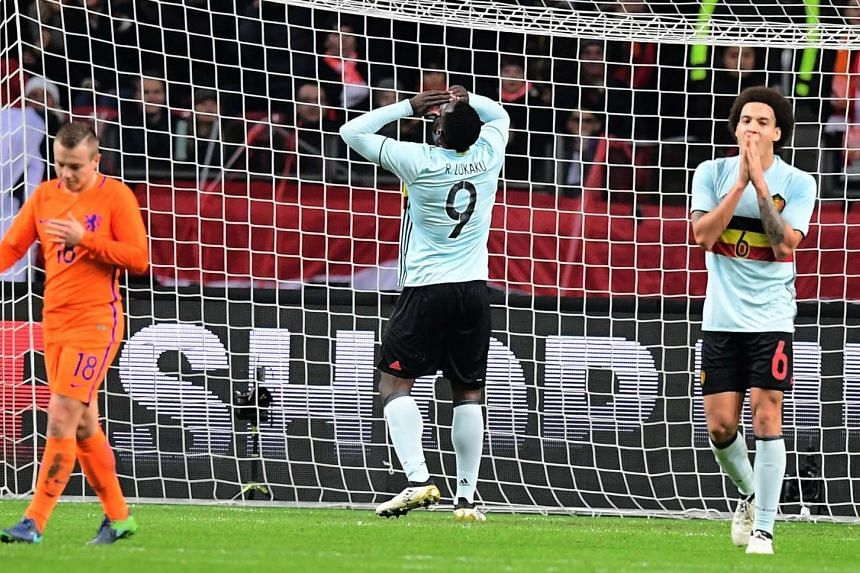 Romelu Lukaku (centre) reacts after missing a goal during a friendly football match between The Netherlands and Belgium at the Amsterdam Arena on Nov 9, 2016.