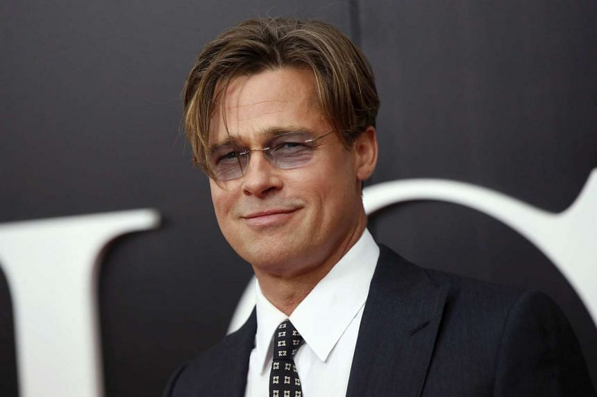 Brad Pitt poses on the red carpet at the premiere of The Big Short in New York.