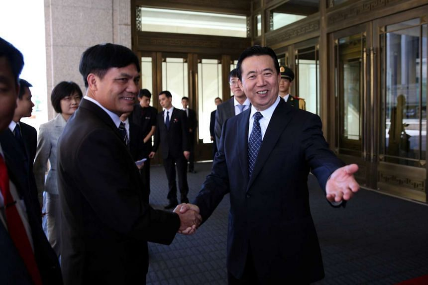 Meng Hongwei (right), Chinese vice public security minister, shakes hands with Nguyen Quang Dam, commandant of the Vietnam Coast Guard, in Beijing.