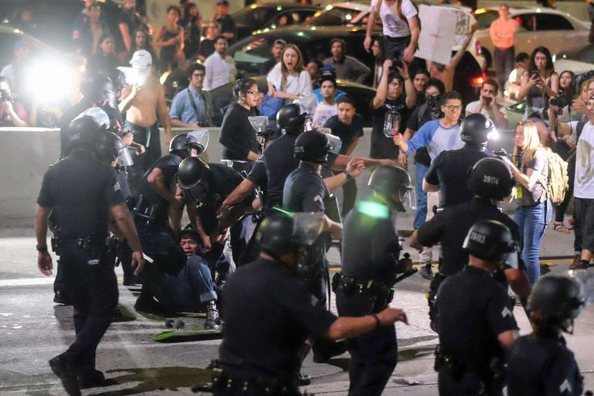Police arrest demonstrators after they shut down the 101 Freeway following a rally to protest a day after president-elect Donald Trump's election victory in Los Angeles, California, late on Nov 9, 2016.