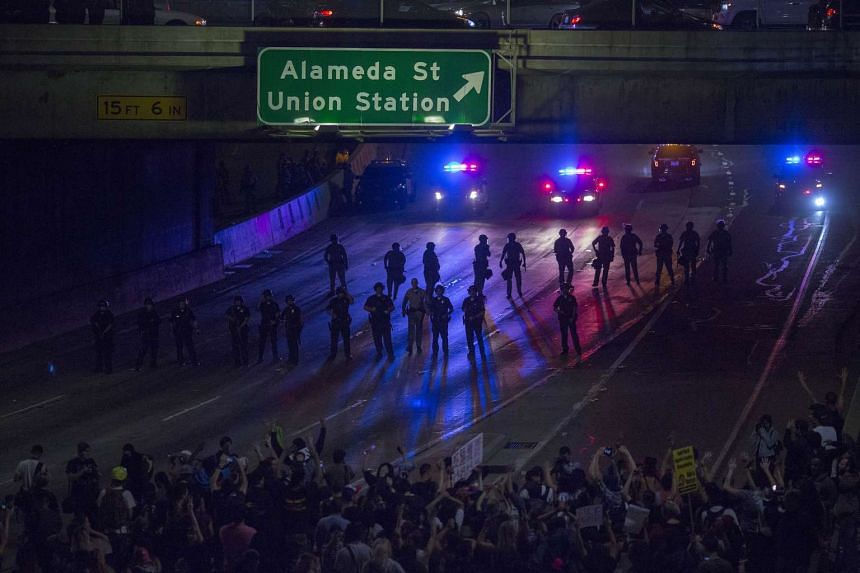 Police advance on protesters who shut down the 101 freeway in opposition to the upset election of Donald Trump as President of the United States on Nov 9, 2016 in Los Angeles, California.