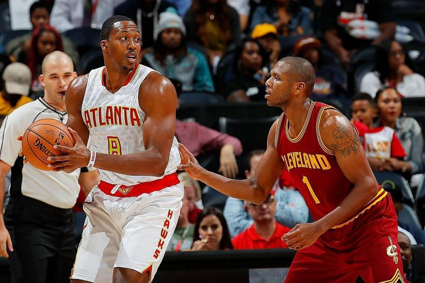Dwight Howard of the Atlanta Hawks looks to drive against James Jones of the Cleveland Cavaliers at Philips Arena on Oct 10, 2016, in Atlanta, Georgia.