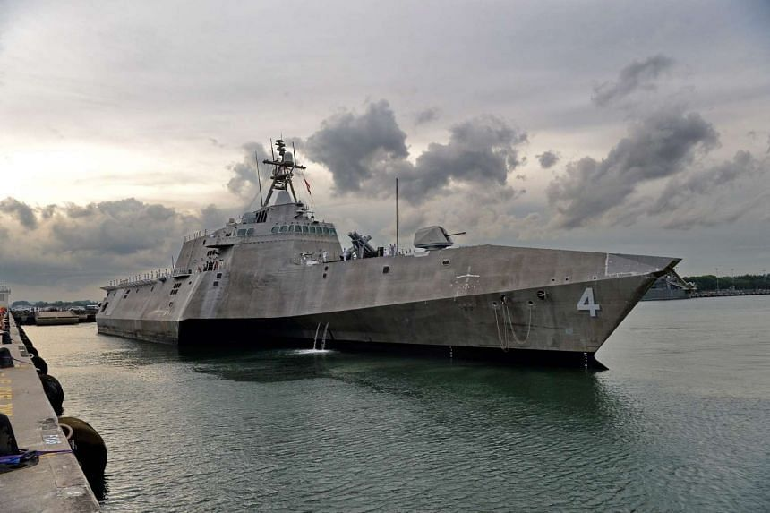The US Navys USS Coronado (LCS 4) is guided by pilot boats (unseen) as she docks at Changi Naval Base in Singapore on Oct 16, 2016.