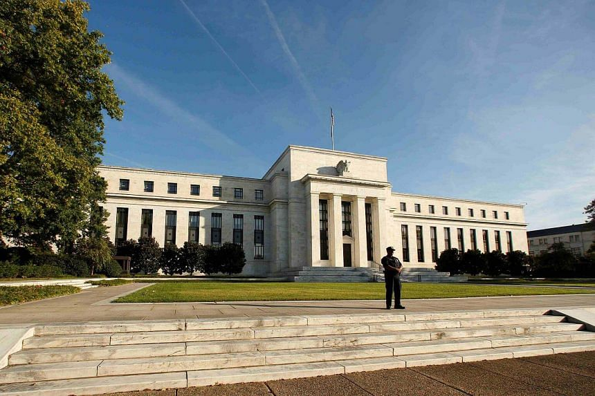 A police officer keeps watch in front of the US Federal Reserve building in Washington, DC, US, on Oct 12, 2016.