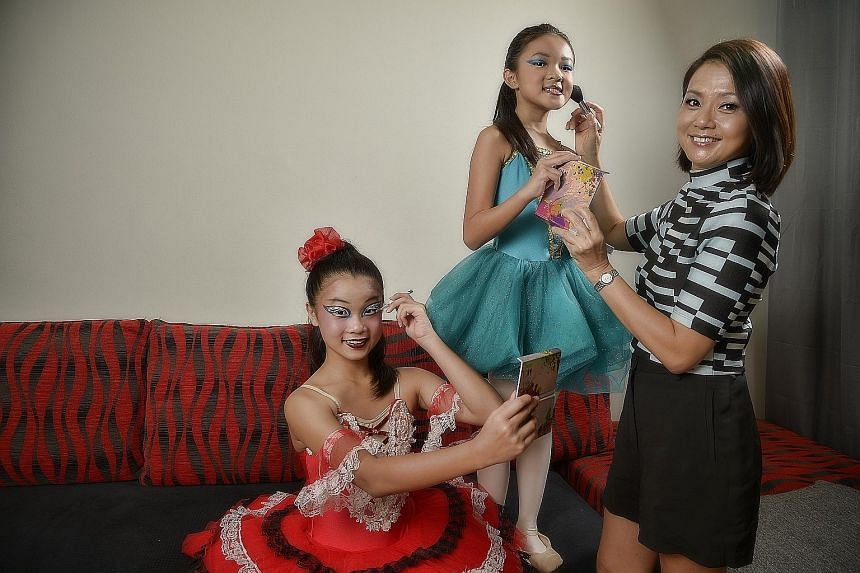 Founder of C'est Moi Jessica Tang, with her daughters Isabelle (centre) and Annabele.