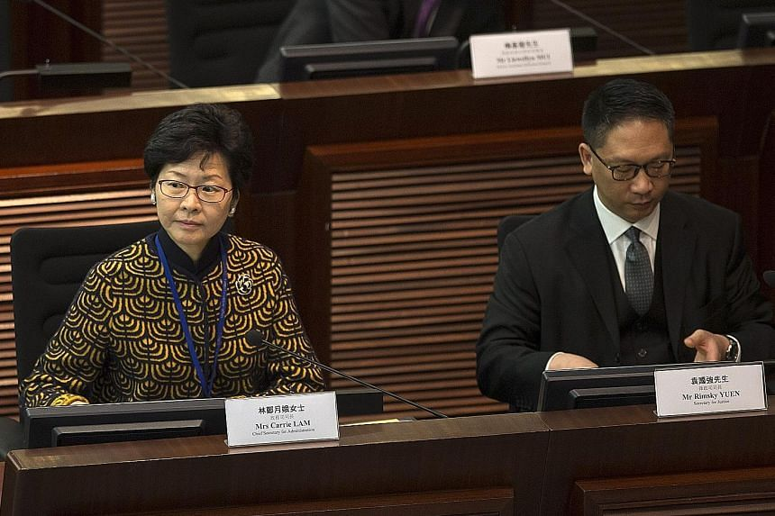 Mrs Lam and Mr Yuen being questioned at Hong Kong's Legco yesterday. Mr Yuen reiterated that Beijing has the right to interpret the Basic Law and this will not undermine Hong Kong's judicial system.
