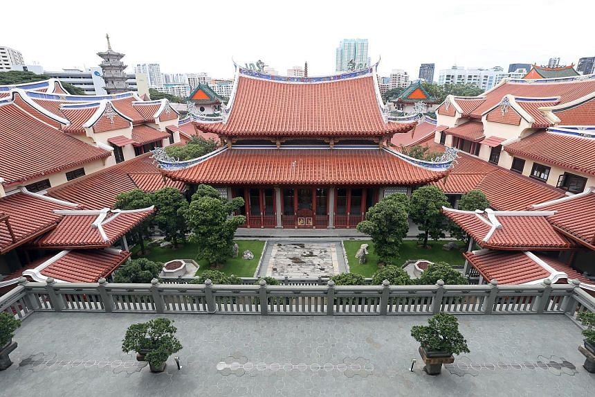 The tranquil and secluded Lian Shan Shuang Lin Monastery was completed in the 1900s and its Mahavira Hall and the Hall of Celestial Kings were gazetted as national monuments in 1980. Above: The monastery's Mahavira Hall. Left: An exhibition - to be h