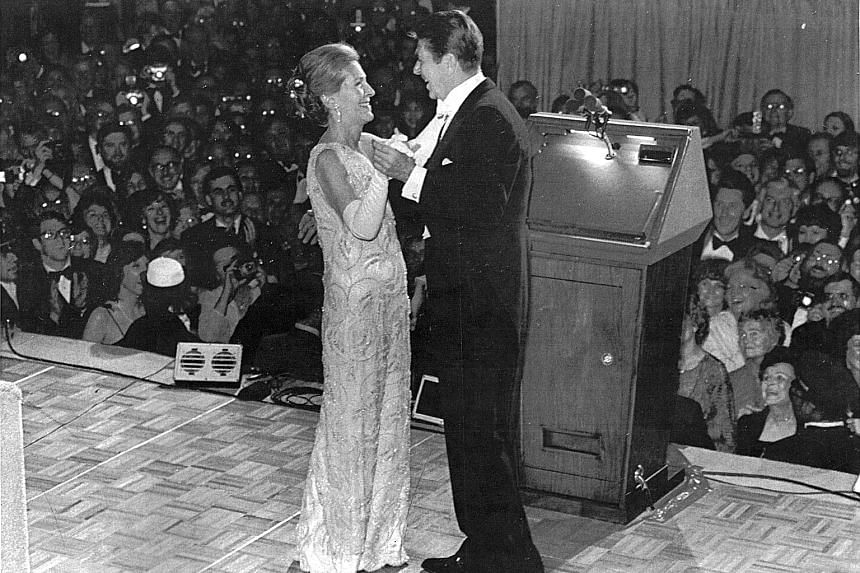Mrs Nancy Reagan at the inaugural ball for her husband Ronald Reagan (both left), in a gown by James Galanos, in Washington in 1981.