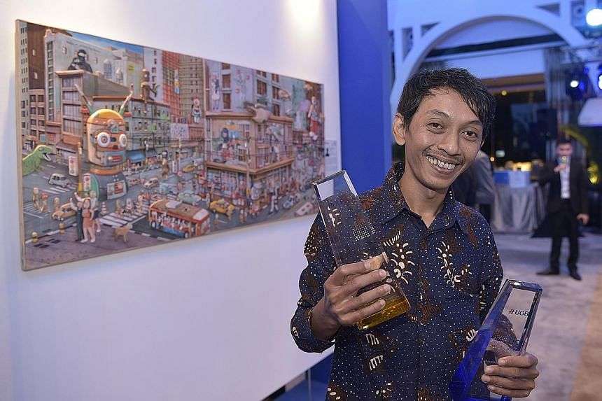 Jubilant Indonesian artist Gatot Indrajati after winning the 35th United Overseas Bank Painting of the Year (Indonesia) Award last night. He is also the third Indonesian in a row to win the UOB South-east Asian Painting of the Year Award, the first t