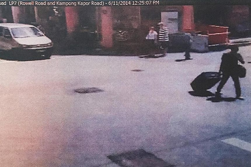 Left: An image from the Verdun-Syed Alwi junction. Ramzan said he was the one in black pulling the suitcase, while the man in white beside him was Rasheed. Right: An image from the Rowell-Kampong Kapor junction.