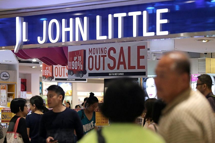 Shoppers checking out the closing sale at John Little's Plaza Singapura outlet on Monday. The department store will be revived next year as a pop-up concept.