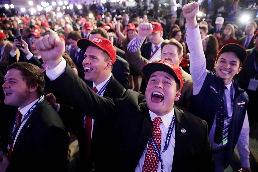 Supporters (above and below) of Republican presidential nominee Donald Trump cheering the results at an election night event at the New York Hilton Midtown.