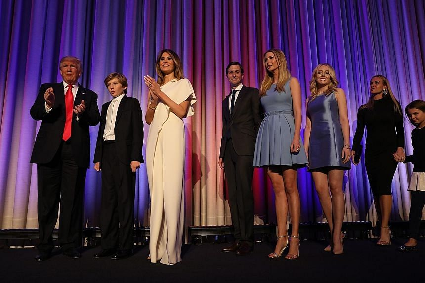 Mr Trump on stage with his family to celebrate winning the election in New York yesterday. No other presidential candidate has given offence so freely and been so battered by scandal, and lived to fight on and win.