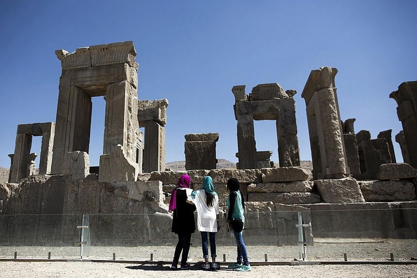 Iranians visiting the palace of King Darius in the ancient Persian city of Persepolis near Shiraz in southern Iran in September 2014. The Islamic republic is now a booming destination for Europeans seeking an adventurous vacation. Even tourism from t