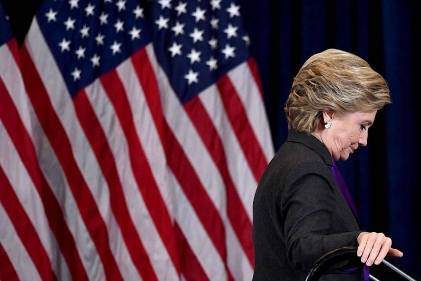 US Democratic presidential candidate Hillary Clinton leaving after making a concession speech following her defeat to Republican President-elect Donald Trump.