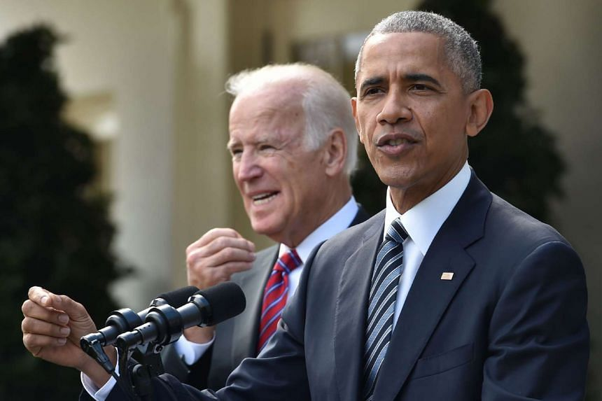 Obama (right) together with US Vice-President Joe Biden (left) adresses, for the first time publicly, the shock election of Donald Trump as his successor.