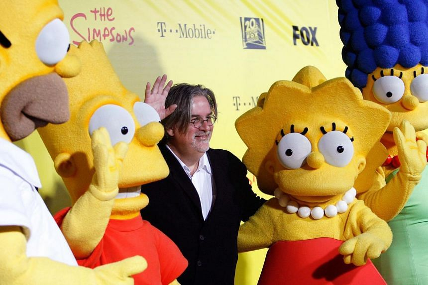 Matt Groening (centre), creator of The Simpsons, poses with characters from the show.