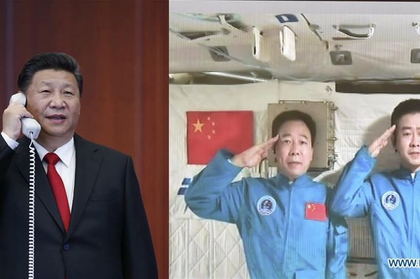 Chinese President Xi Jinping greets two Chinese astronauts aboard the Tiangong II space lab during a video call.