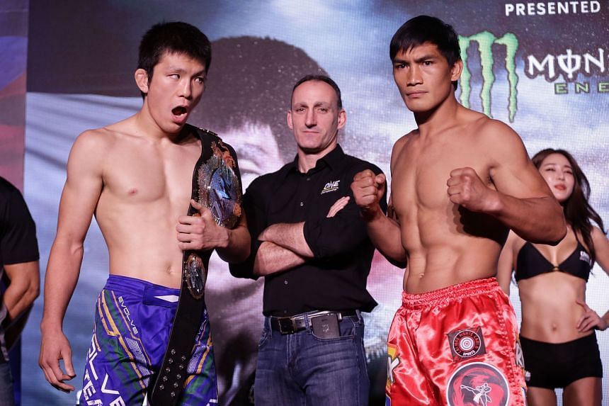 Japan's Shinya Aoki (left) will defend his One Championship mixed martial arts lightweight title against the Philippines' Eduard Folayang at the Singapore Indoor Stadium tomorrow evening. Their contest is one of two title bouts headlining One Champio
