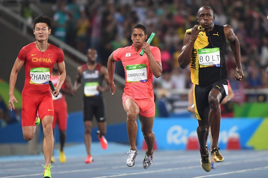 Japan's Aska Cambridge (centre) racing against Jamaica's Usain Bolt and China's Zhang Peimeng in the men's 4x100m relay final at the Rio Olympics. Japan won a surprise silver.