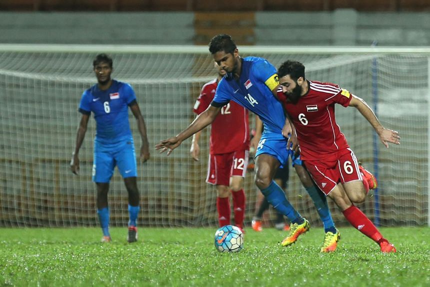 Singapore captain Hariss Harun being tackled by Syria's Amro Jeniat, who scored the first goal in the Middle East side's 2-0 win in Paroi. Hariss says his team need to cut out mistakes at the back. The Lions play Cambodia at Bishan Stadium on Sunday in th