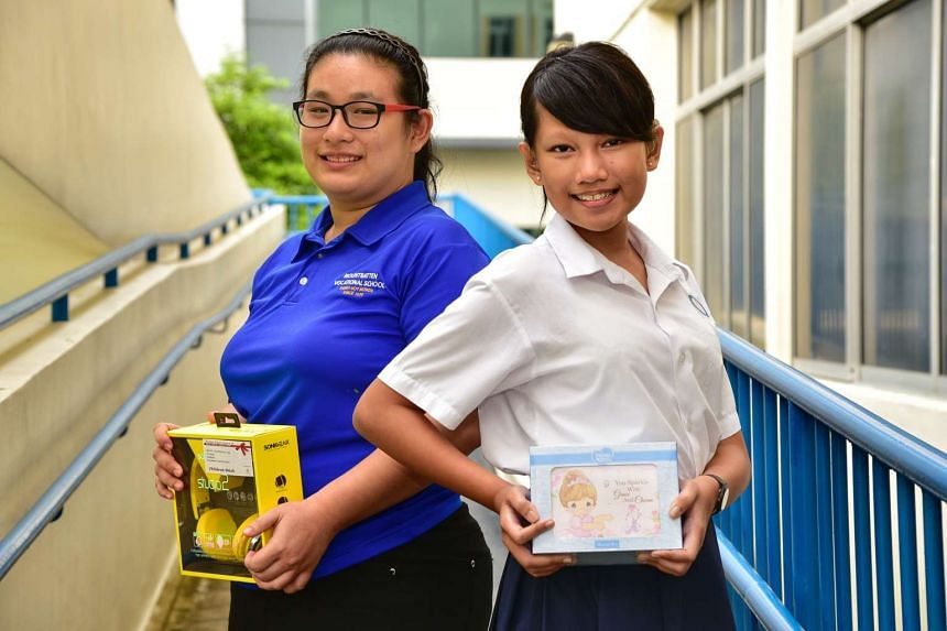 Above: Joyce Ong and Raja Elisa Amanda, 14, with their gifts.