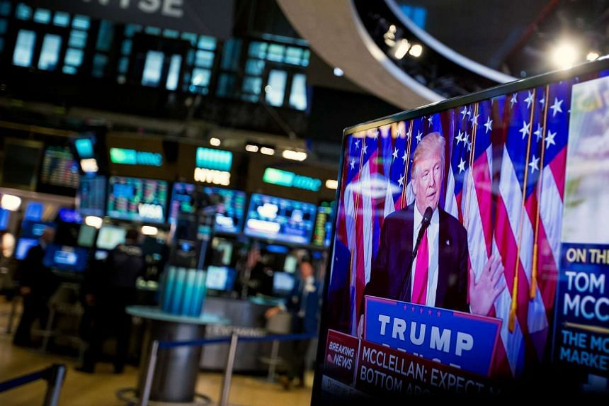 US President-elect Donald Trump is seen speaking on a television on the floor of the New York Stock Exchange (NYSE) in New York on Nov 9, 2016.