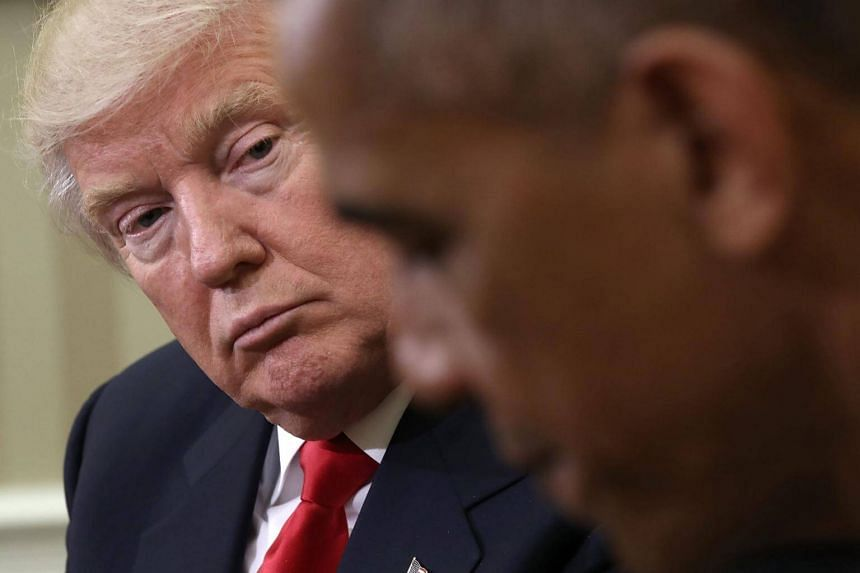 US President Barack Obama speaks while meeting with President-elect Donald Trump (left) following a meeting in the Oval Office on Nov 10, 2016.