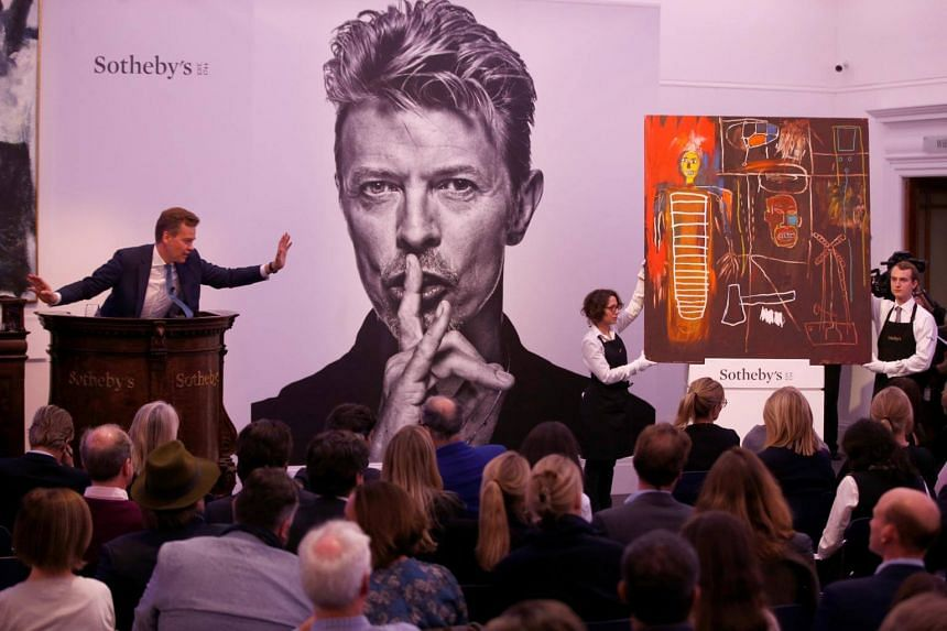 Jean-Michel Basquiat's Air Power, owned by the late David Bowie, is sold for £6,200,000 at the Bowie/Collector auction.