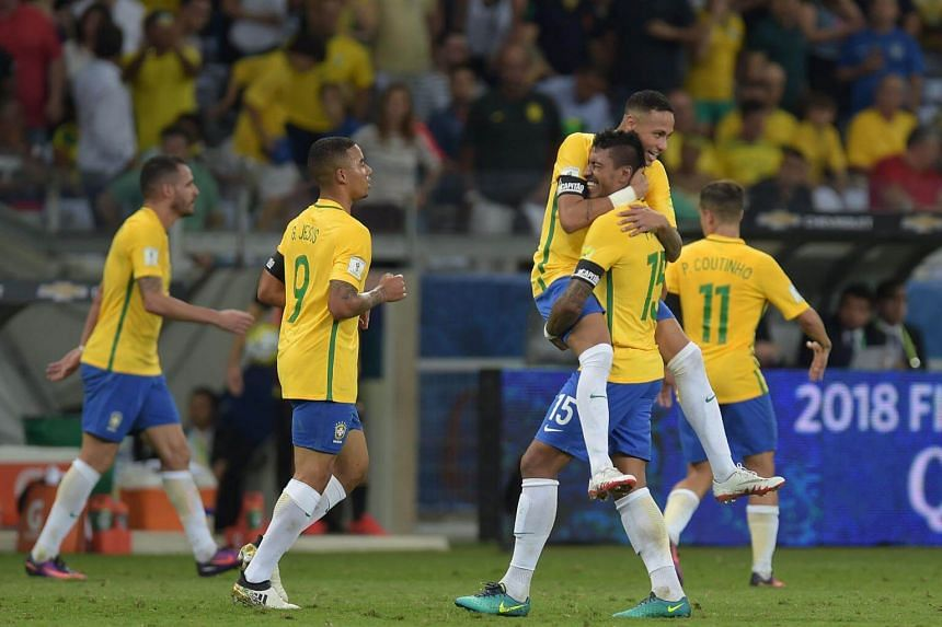 Brazil's Paulinho (15) celebrating with Neymar after scoring against Argentina during their 2018 Fifa World Cup qualifier football match in Belo Horizonte, Brazil, on Nov 10, 2016.