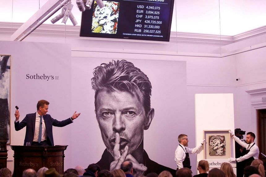 An auctioneer conducting the sale of Frank Auerbach's Head Of Gerda Boehm at the Bowie/Collector auction.