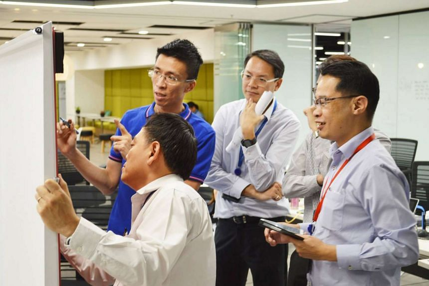 DSTA engineers (from left) Cheng Heng Ngom, Wong Rong Fah, Benedict Koh and Mui Whye Kee were part of the core team that helped determine the cause of the glitch in the Circle Line.