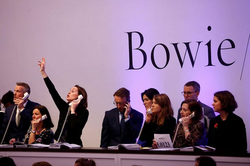 A telephone bid is placed during a sale at the Bowie/Collector auction.