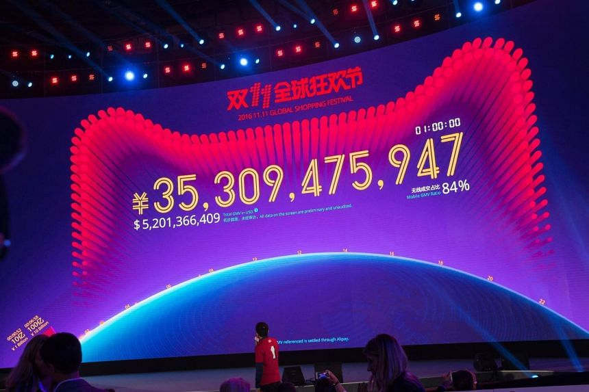 A giant electronic display shows the amount in Chinese yuan and US dollars of online transactions one hour after the launch of the Alibaba 11.11 Global Shopping Festival Gala in Shenzhen.